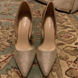 JoJo Fox rose gold metallic heels.